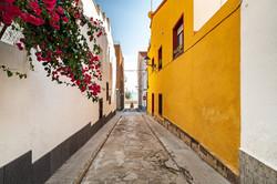 narrow street towards the sand beach