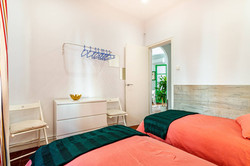 Bedroom I: 2 single beds, commode, m