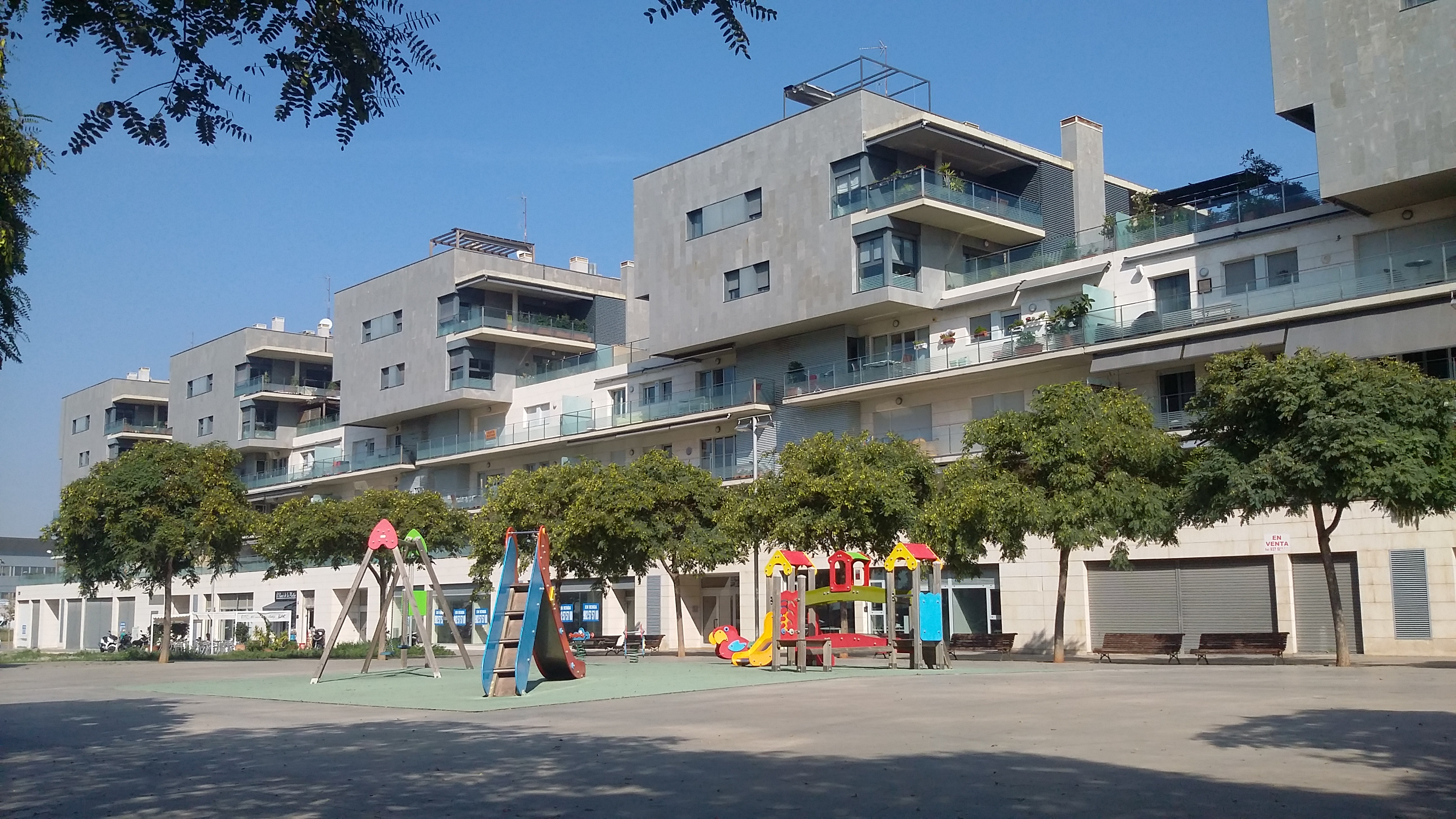 children´s playgrounds in front and behind the apartment´s building.