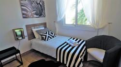 Bedroom III: 1 single bed, seat
