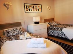 Bedroom II: 2 single beds, commode,