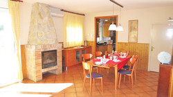 party room with dining table and open chimney