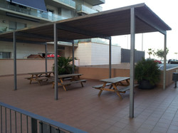 wooden tables and benchs for pic-nic in the inner courtyard.