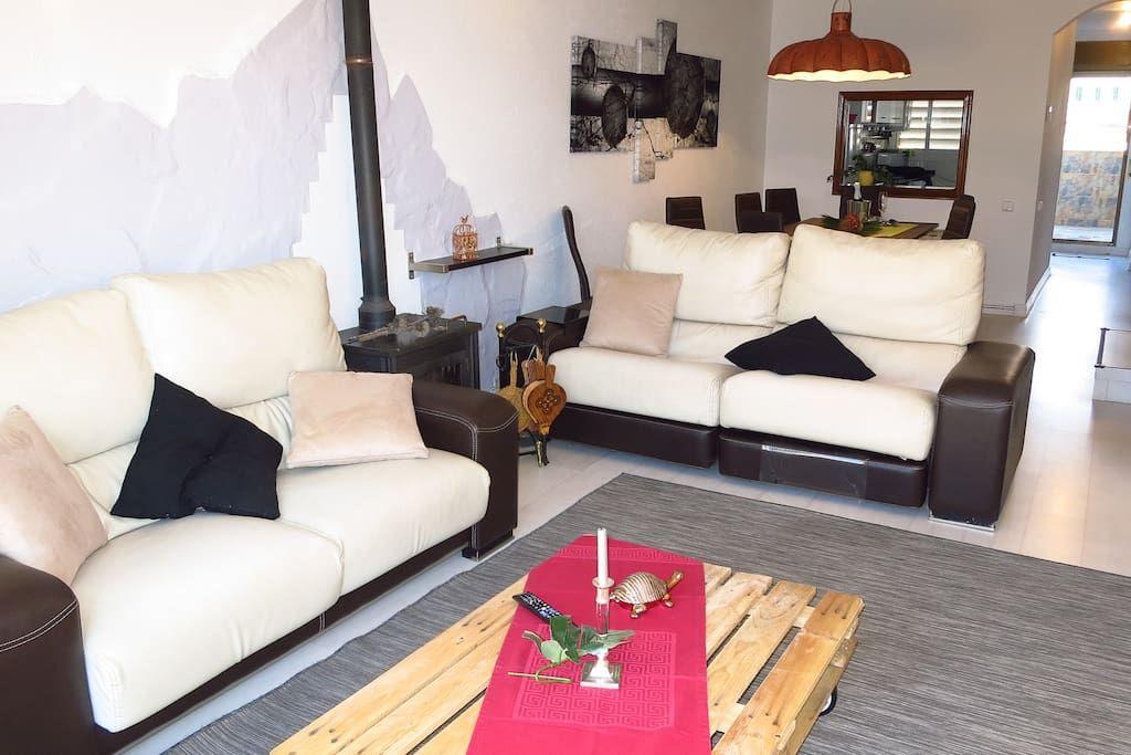 living room, 2 sofas, beside table, oven