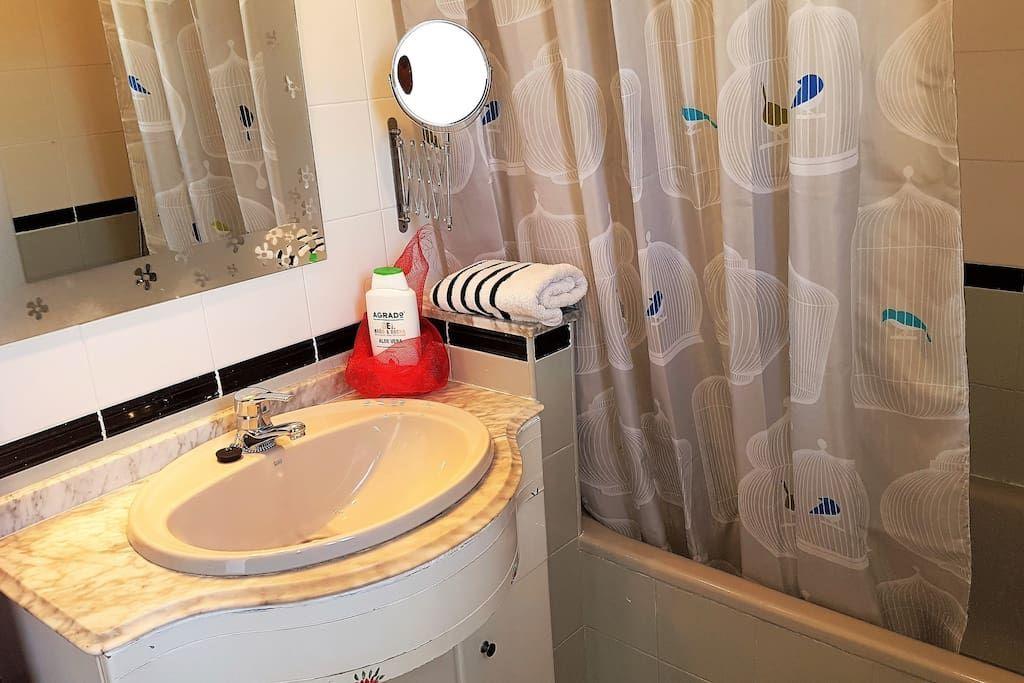 Bathroom features bath-tube,shower, bidet, hair dryer, shampoo