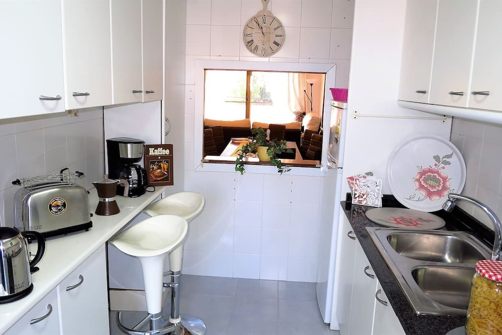 fridge, oven, microwave, dish-washer, kettle, toaster, coffee machines.