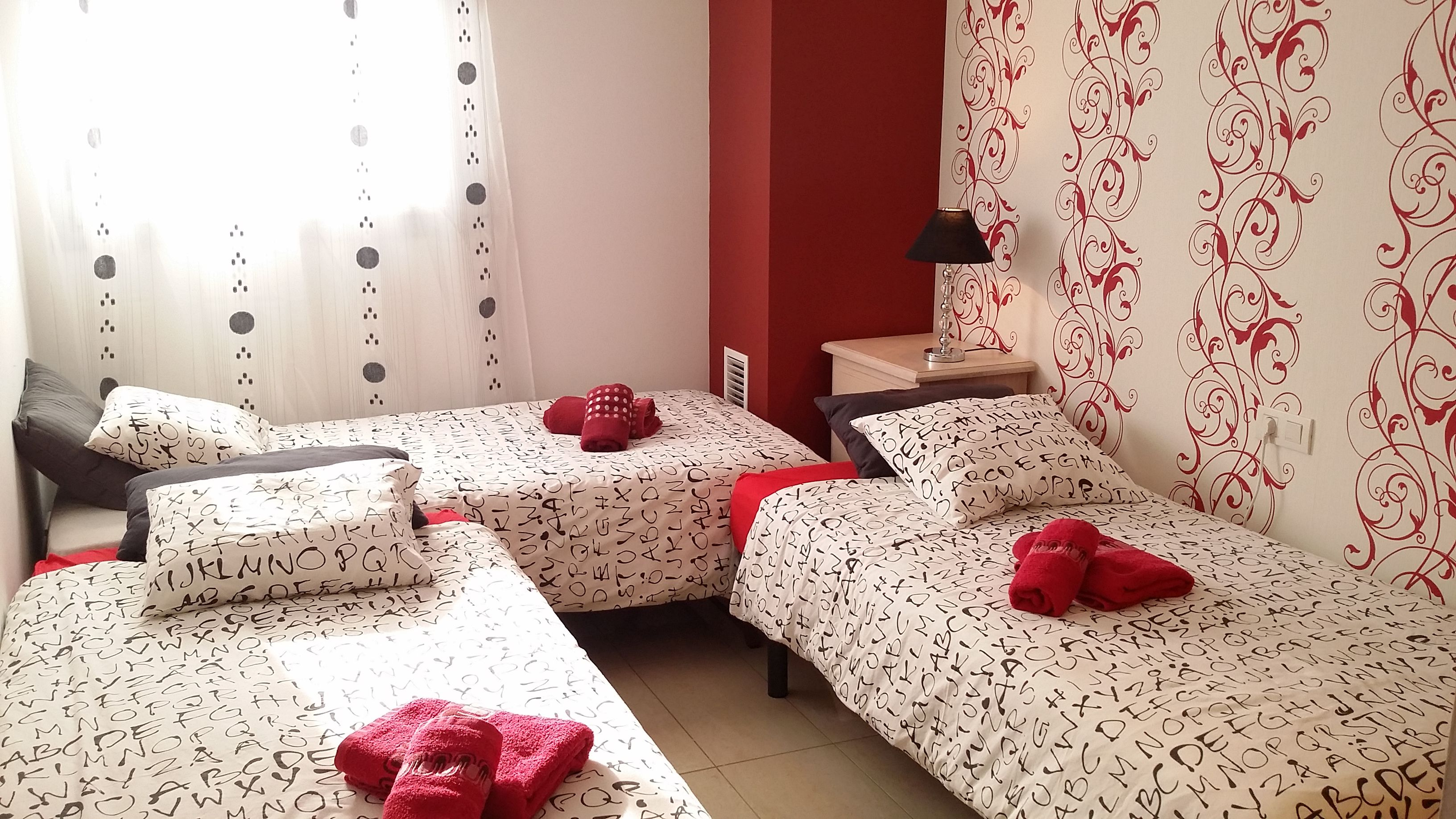 """bedroom III"": 3 single beds, beside table, wardrobe"