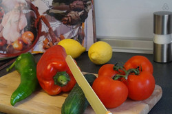 prepare fresh spanish vegetables and fruits, bought at the local marketplace.