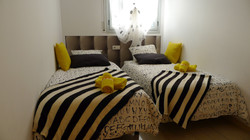 """bedroom II"": 2 or 3 single beds, wardrobe"