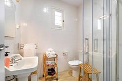 Bathroom: shower, hair dryer, soap,