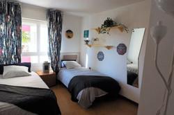 Bedroom III 2 single beds, wardrobe, mirrow