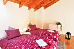 Bedroom V  2 single beds, sofa, table, balcony