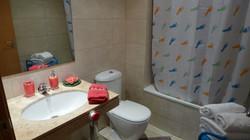 """bathroom II"": bath-tube/shower, shampoo, soap."