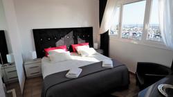 Bedroom I: 1 double room, wardrobe, make-up-desk, sea view