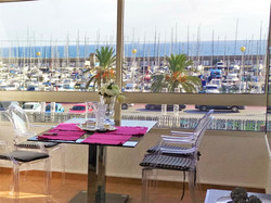Living room with view to the Marina Port and the sea