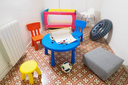 nursery high chair and cot for a baby