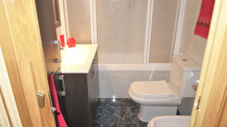 Bathroom with bath-tube/shower, bide
