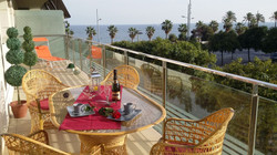 long balcony with fantastic view to the sea and the hills