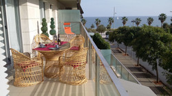 long balcony, table, chairs, sunlounger