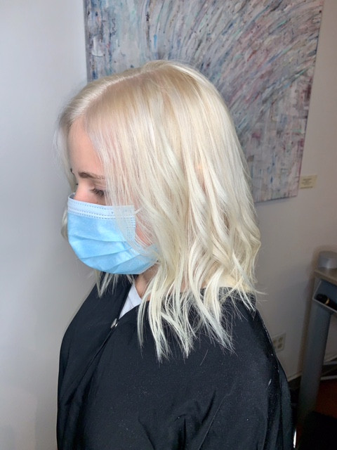 After a full bleach and tone, she h as super icy hair.