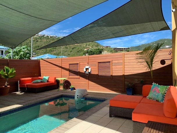 Deck Orange couches and pool 2.JPG