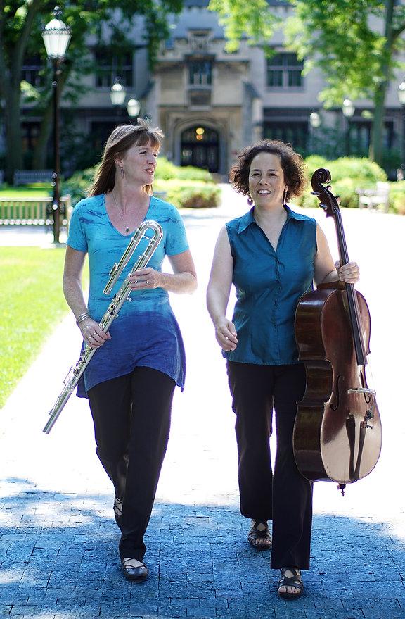Flutist, Lisa and cellist, Erica walking together