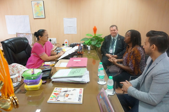 Exchanging ideas with the school director