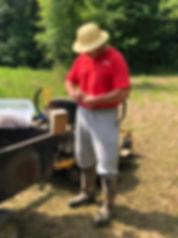 Man in hat lighting a smoker