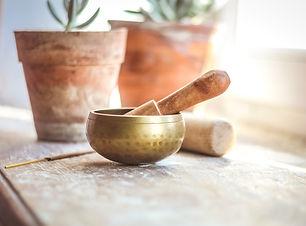 Tibetian singing bowl in cozy interior, witt ceramic pot with succulents, insence for medi