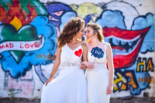 two brides white dresses looking one on