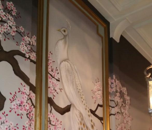Wandschildering witte pauw