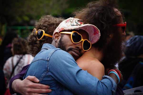 Diverse Men Hugging Photo by Dimitar Belchev on Unsplash. LGBT diversity relationship Therapy counseling Berkeley Albany