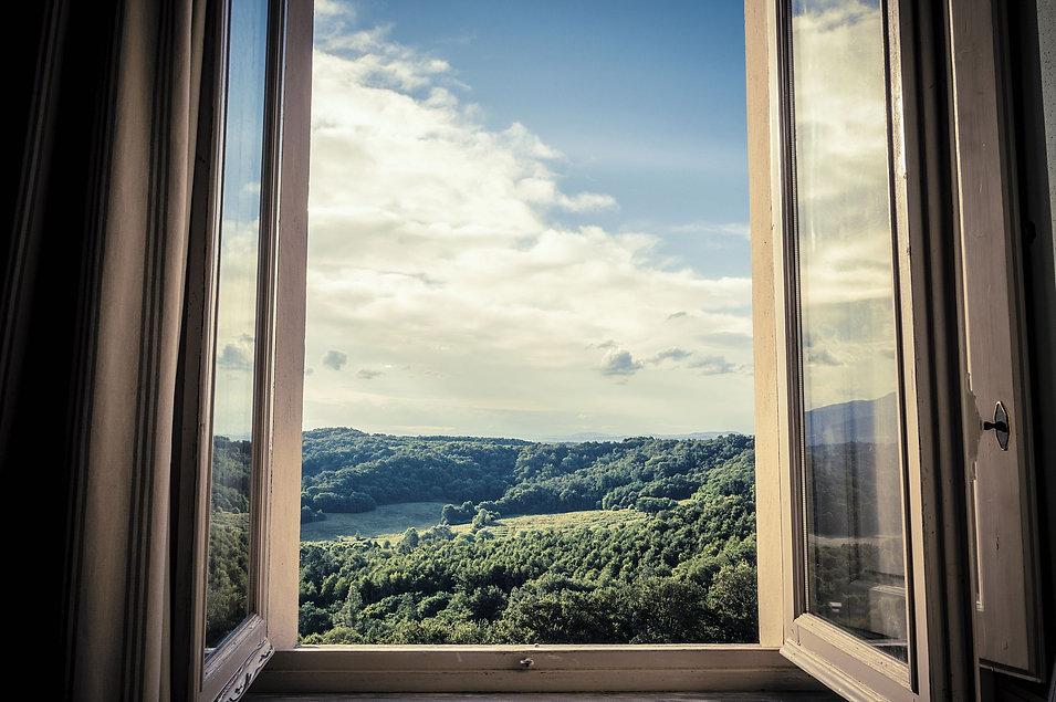 mountains-seen-through-window-royalty-free-image-1595003368.jpeg