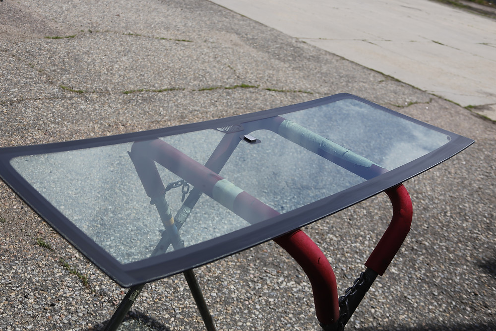 New clean windshield on a glass stand