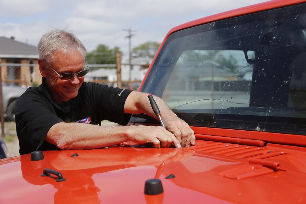 Cornerstone Auto Glass Lil John removing windshield wipers