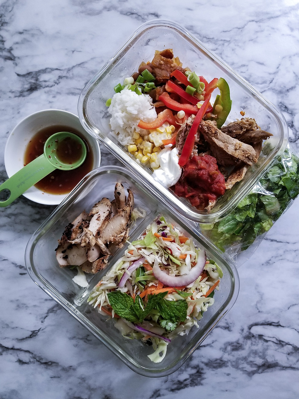 Food portioned in containers.