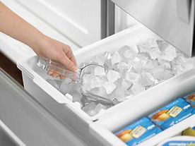 ice in a bucket,icemaker making ice