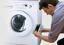 technician repairing a dryer