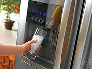 ice coming out of refrigerator dispenser
