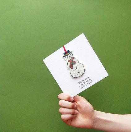Christmas card and hand.jpg