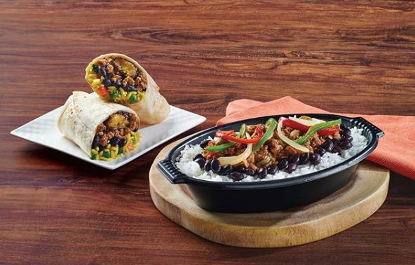 "Pollo Tropical now has Vegan versions of its Tropichop and Wrap featuring a ""picadillo"" made with"