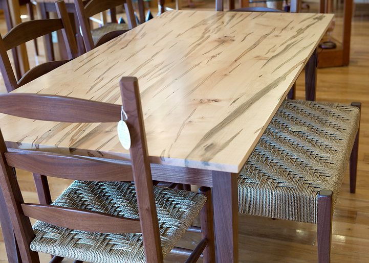 Ambrosia Maple and Walnut Dining Table; Walnut and Seagrass Chairs and Bench