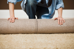 Woman Rolling Carpet