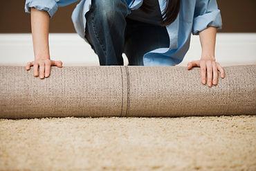 Woman Rolling Carpet