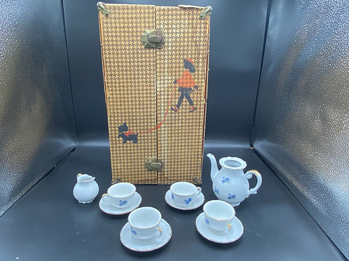 Vintage doll trunk and child's tea set
