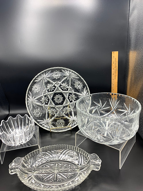 Crystal and pressed glass servingware.