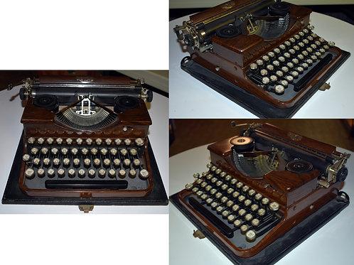 Vintage Royal Woodtoned portable type writer