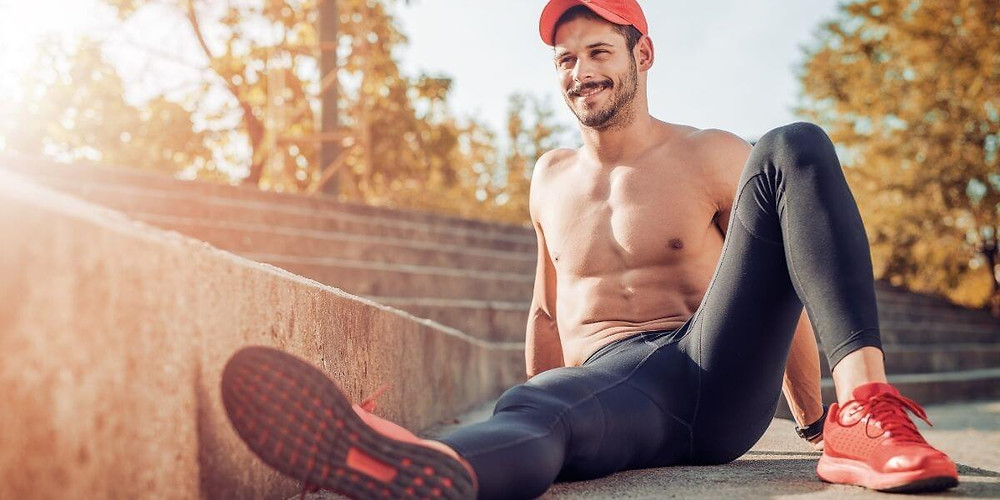 Smiling man wearing compression tights.