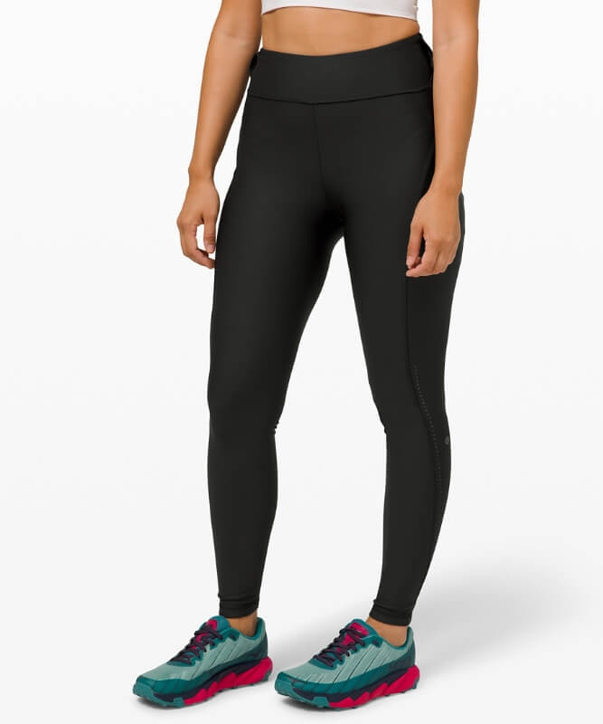 Athlete wearing Lululemon Chase the Chill Super High-Rise tights.