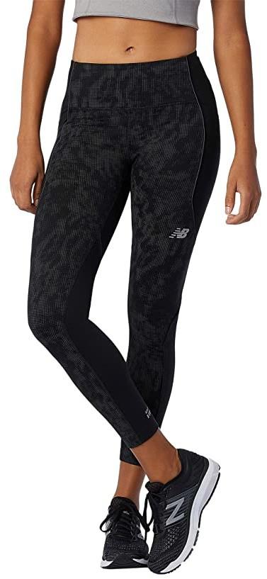 Athlete wearing New Balance Reflective Impact Run Heat tights.